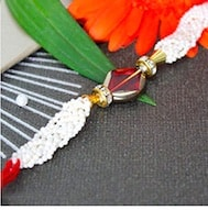white bead rakhi